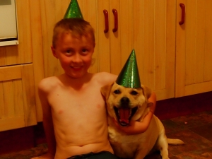 My Birthday Boy and Minty Dog Celebrating Birthday number 9.  Who has the biggest smile?